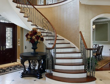 Circular staircase luxury home foyer