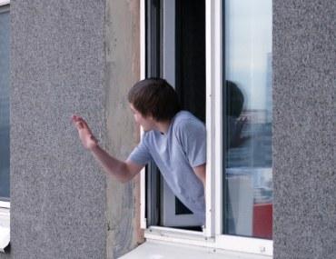 Neighbours talking through the window
