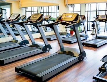 A row of treadmills in a gym