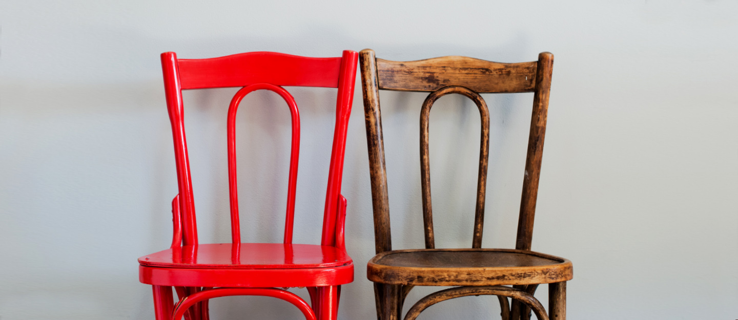 A wooden and a painted chair