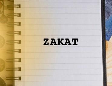 A notebook with Zakat written on it