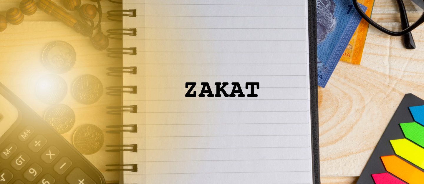 A notebook with Zakat written on it