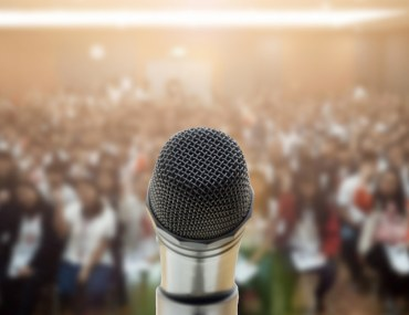 An Opportunity for Public Speaking with a mike in front of an audience