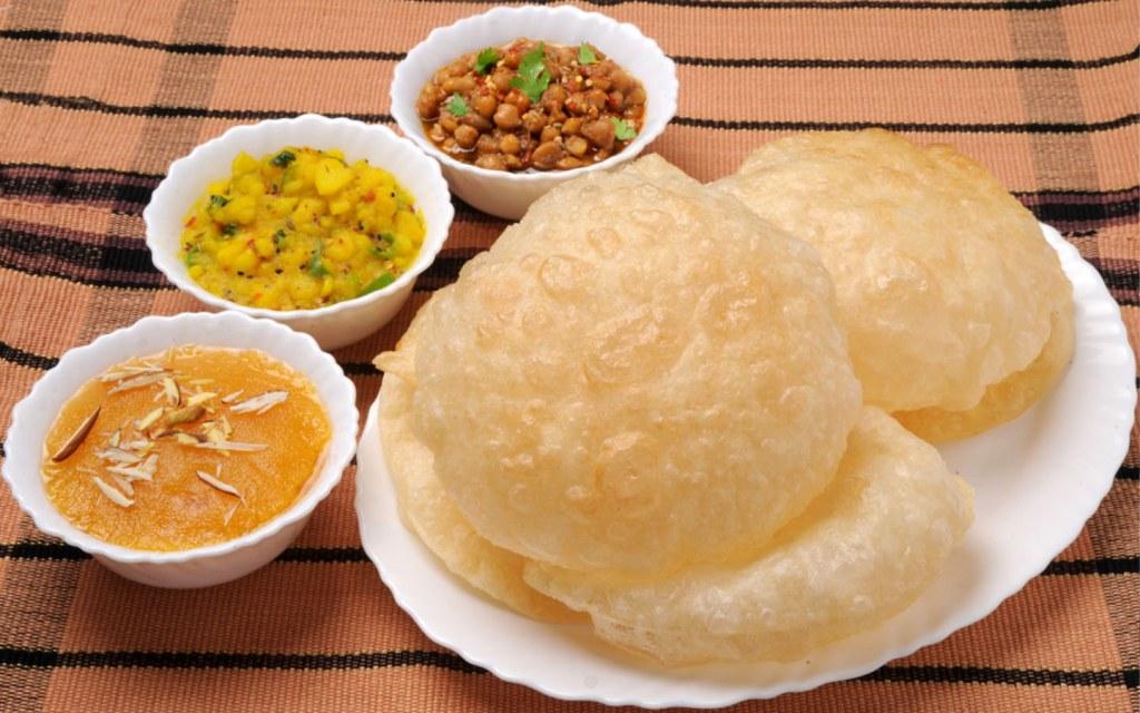halwa puri is a famous breakfast delicacy in karachi