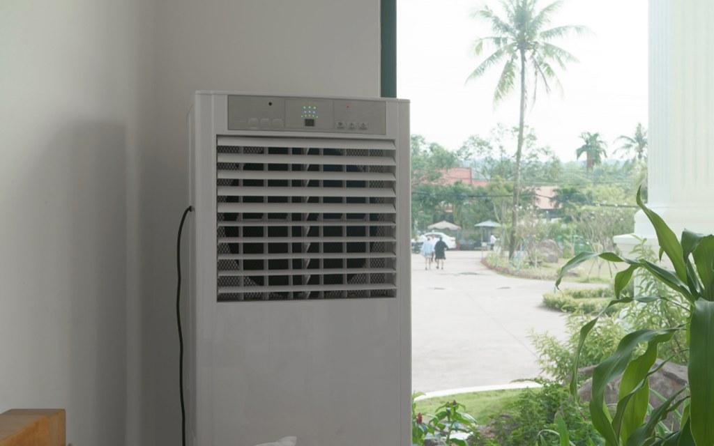 Air cooler beside a window