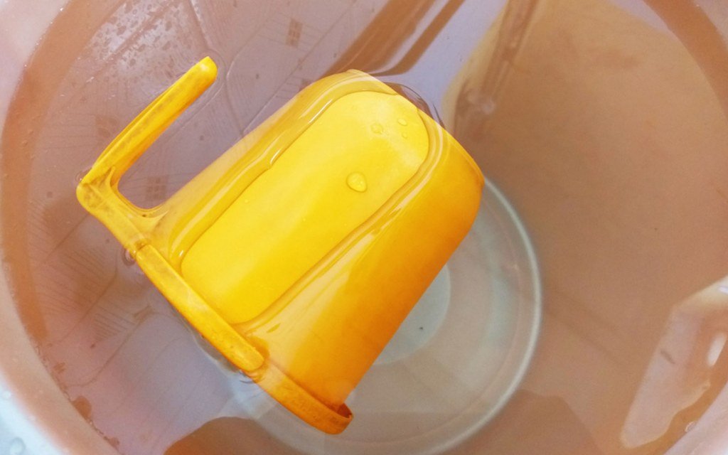 Bucket under shower can help you save bath water