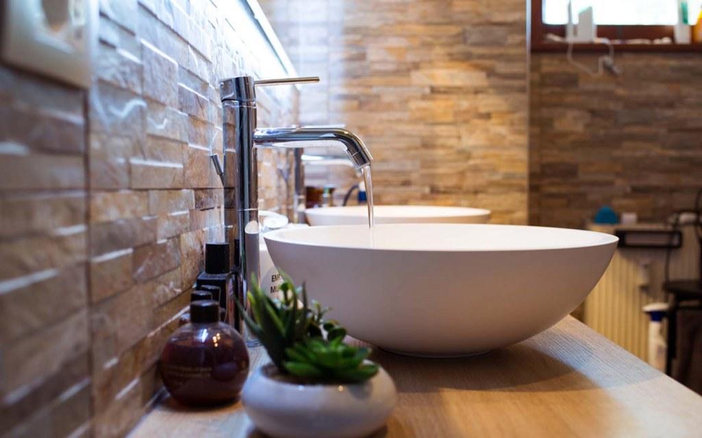 A vessel sink has a deep bowl