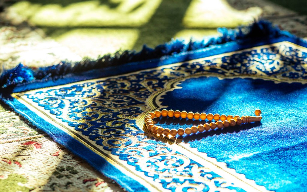 Rosary on a praying mat