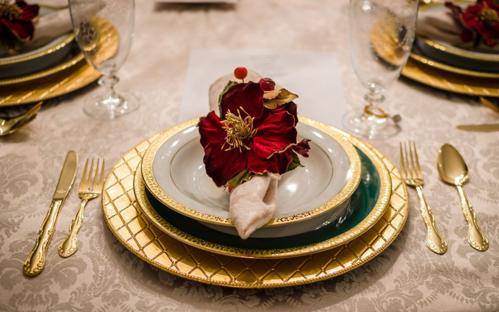 Modern cutlery with beautiful flower and napkin