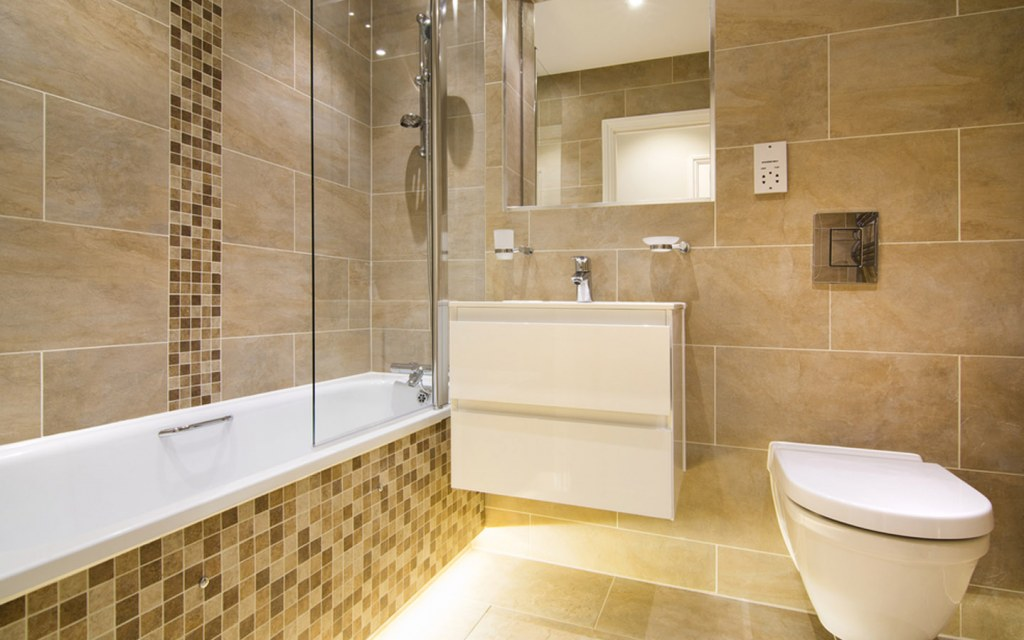 Stone tiles installed on bathroom floor and walls
