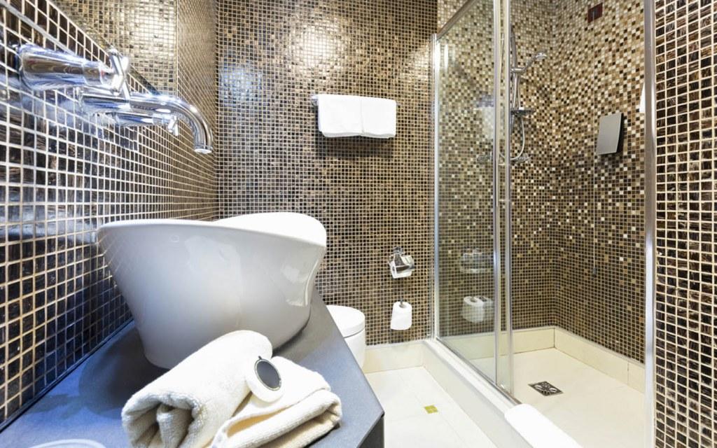 Glass tiles on bathroom walls