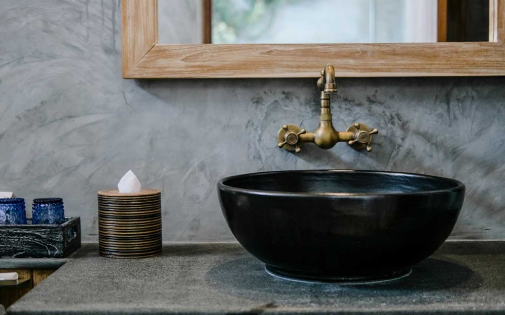 Brass and copper sinks in bathroom