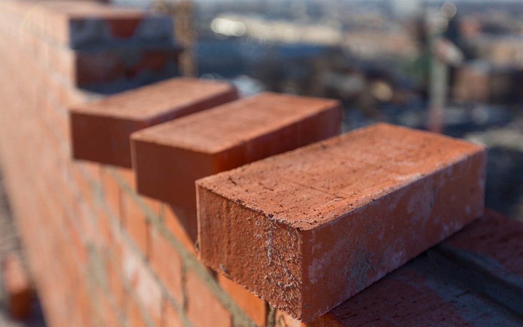 how much bricks are needed in building the grey structure of a house
