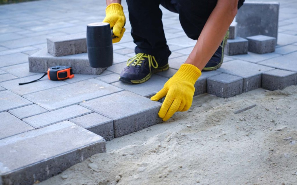 You need to hire labourers to lay the foundation of a house