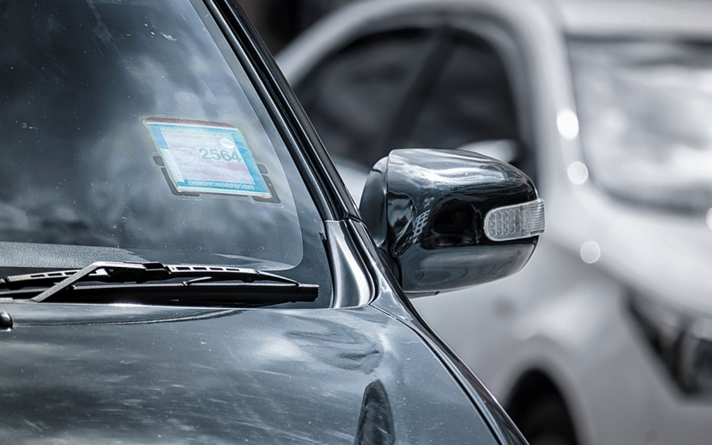 Tax Tokens are displayed on car windshields