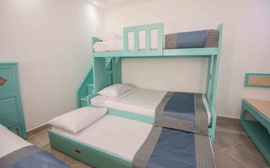 Make space for three in a single frame with a bunk plus trundle bed
