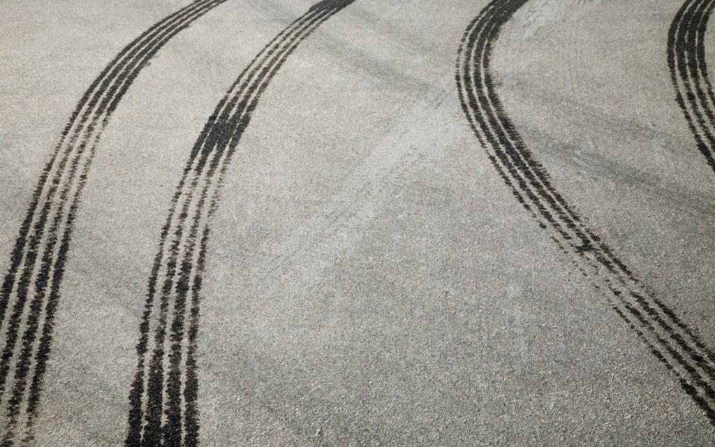 Mud tracks on driveway