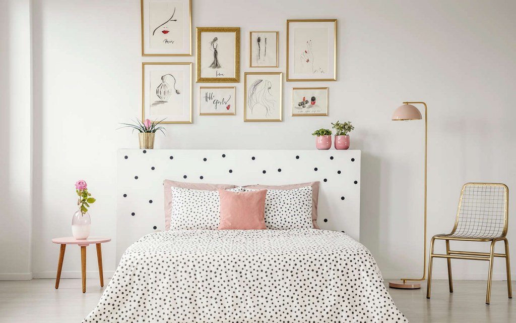 create a gallery wall above the bed