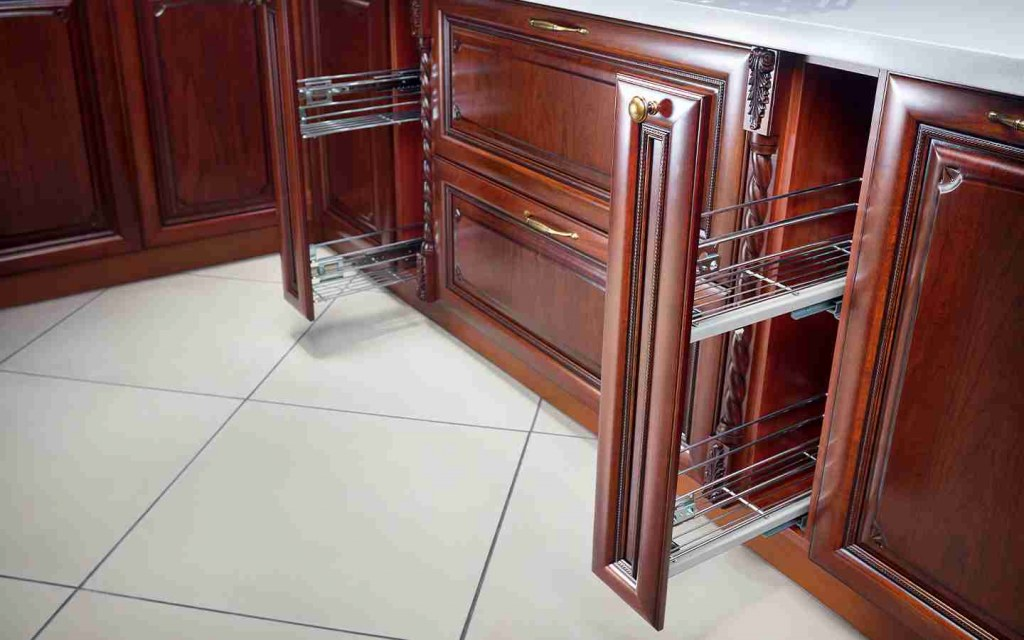 place pull-out spice racks in the kitchen