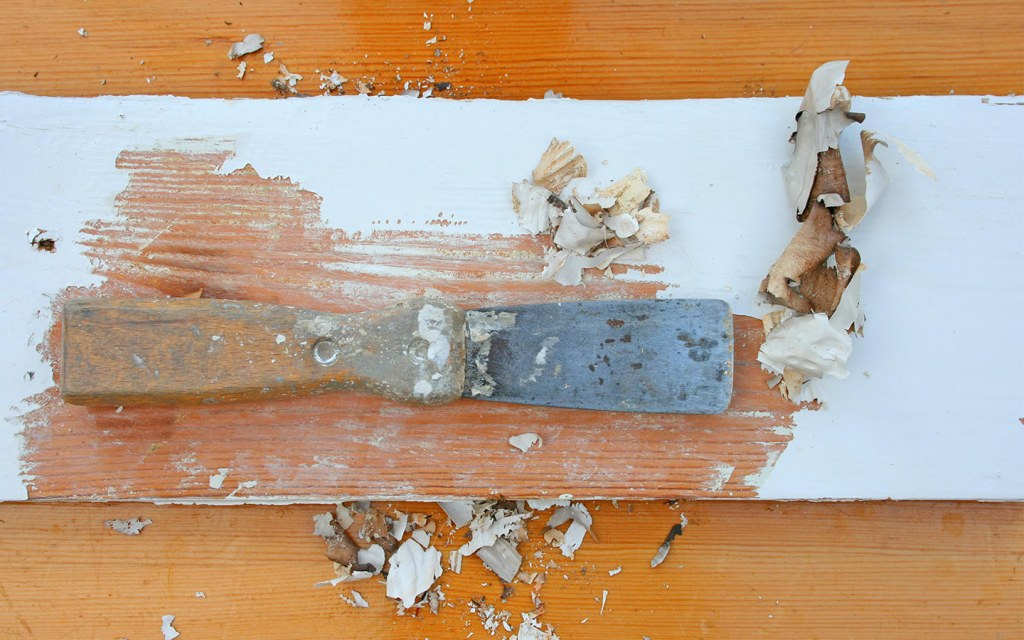 scrape old paint from the hardwood floor