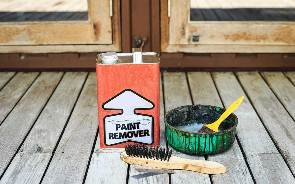 Use paint remover to remove oil-based paint from the wooden floor