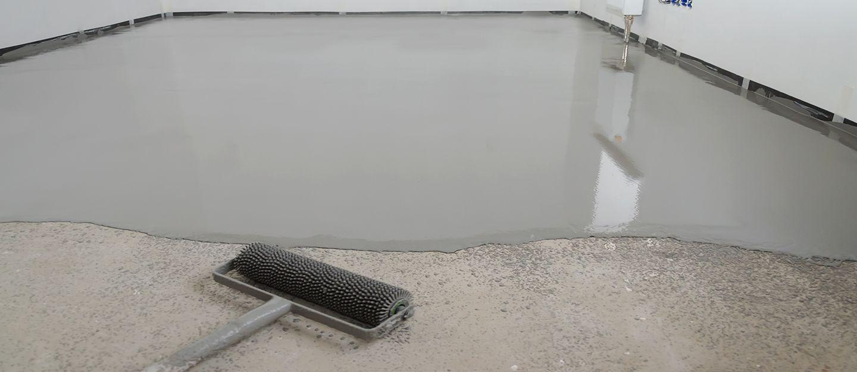 apply epoxy paint on a concrete floor