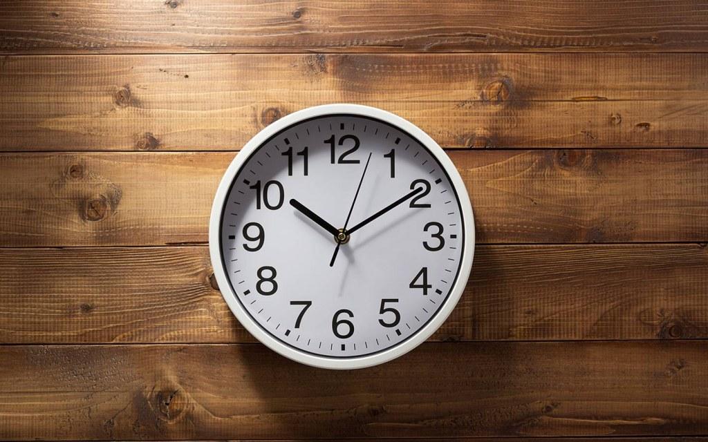 wall clock on a bedroom wall