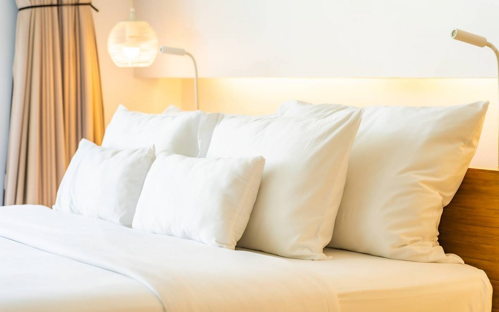bed and pillows in guest room