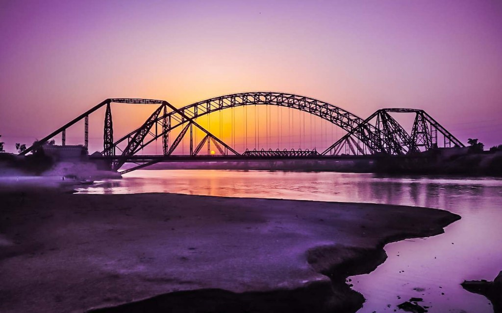 a tied arch bridge is a structure that is based on an overhead arch