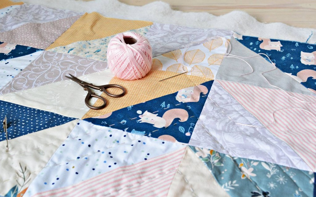 Quilting is essentially a technique through which layers of fabric are patched or stitched together to make one thick cover.
