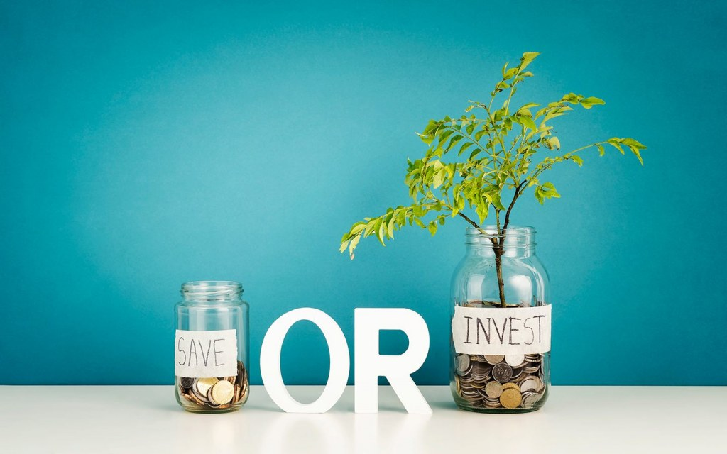 key difference between saving and investing